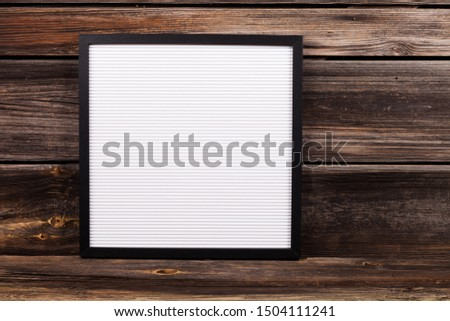 word written with white plastic letters on felt message board at rustic wooden wall, large copy space #1504111241