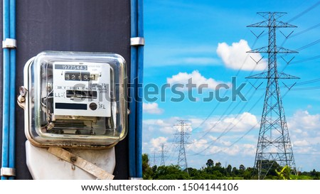 Electric meter for use in home appliances, behind high voltage towers, electric power concepts and electricity usage.