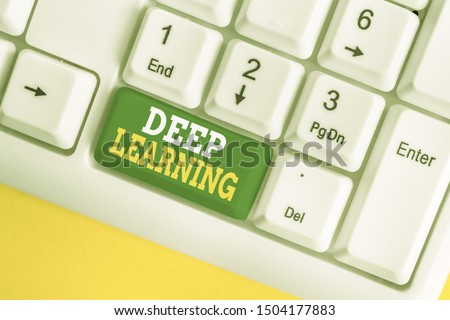 Handwriting text Deep Learning. Concept meaning Hierarchical Abstractions Artificial Intelligence Algorithm White pc keyboard with empty note paper above white background key copy space.