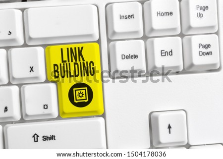 Handwriting text Link Building. Concept meaning SEO Term Exchange Links Acquire Hyperlinks Indexed White pc keyboard with empty note paper above white background key copy space. #1504178036