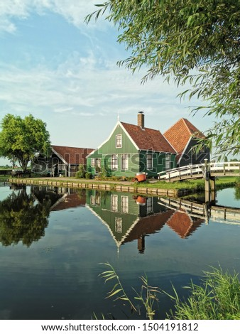 The reflection of a typical house and a bridge in Holland, looks like a painting #1504191812