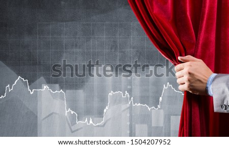 Close up of businessman hand open red velvet curtain to infographs #1504207952