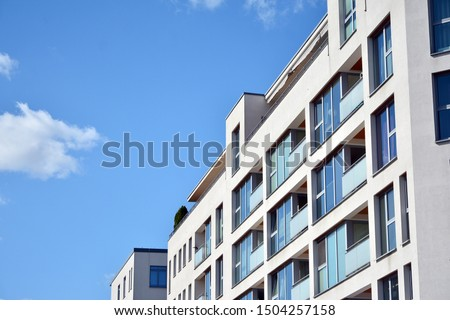 Modern apartment buildings on a sunny day with a blue sky. Facade of a modern apartment building #1504257158