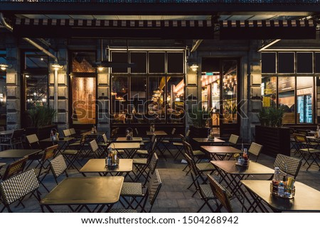 Old street with tables of cafe in center of Brussels, Belgium. Night cityscape of Brussels (Bruxelles). Architecture and landmarks of Brussels. #1504268942
