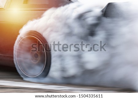 Sport car wheel drifting, Car drifting, Blurred  image diffusion race drift car with lots of smoke from burning tires on speed track. #1504335611