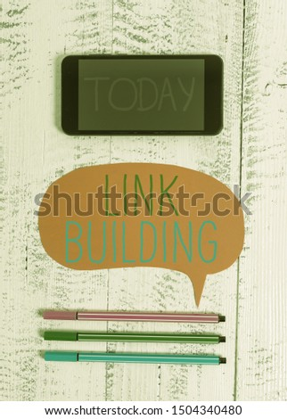 Writing note showing Link Building. Business photo showcasing SEO Term Exchange Links Acquire Hyperlinks Indexed Smartphone cell pens blank colored speech bubble wooden background. #1504340480