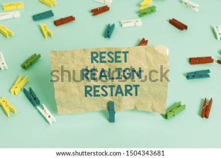 Text sign showing Reset Realign Restart. Conceptual photo Life audit will help you put things in perspectives Colored clothespin papers empty reminder blue floor background office pin. #1504343681