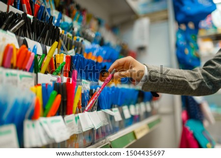 School girl choosing a pen in stationery store Royalty-Free Stock Photo #1504435697