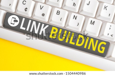 Conceptual hand writing showing Link Building. Business photo text SEO Term Exchange Links Acquire Hyperlinks Indexed White pc keyboard with note paper above the white background. #1504440986