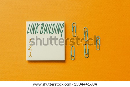 Writing note showing Link Building. Business photo showcasing SEO Term Exchange Links Acquire Hyperlinks Indexed Colored blank sticky note clips gathered trendy cool pastel background. #1504441604