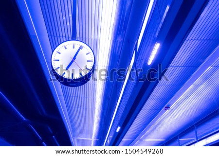 Street clock. On the ceiling with neon lights. Details Architecture #1504549268