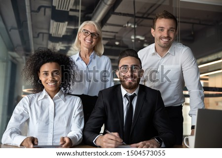 Portrait of pretty successful multi-ethnic corporate close-knit team concept, arabian european african ethnicity office workers pose look at camera four highly paid skilled specialists command indoors #1504573055