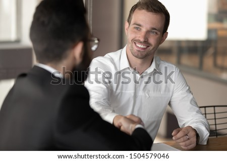Multi-ethnic business partners before starting or accomplish negotiations shaking hands express respect, boss and applicant finish successful job interview hr first impression partnership sign concept #1504579046
