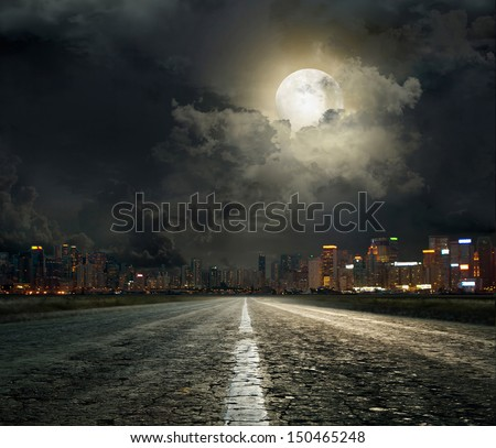 asphalt road leading into the city at night #150465248