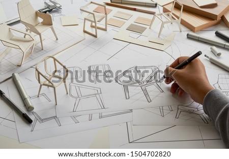 Designer sketching drawing design development product plan draft chair armchair Wingback Interior furniture prototype manufacturing production. designer studio concept .                            #1504702820