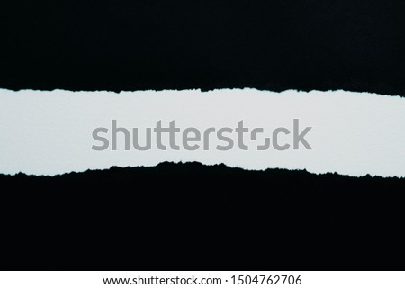 Ripped black paper ,copy space and advertising concept #1504762706