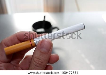 cigarette electronic battery powered vapour e-cigarettes vaping vape stock photo photograph image