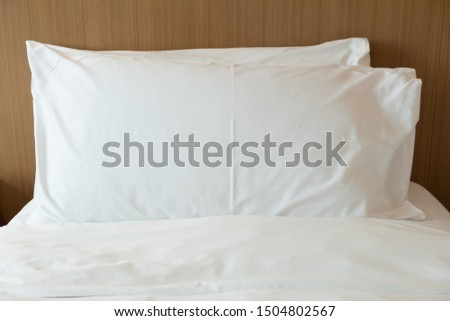 Close up comfortable soft pillows on the bed #1504802567