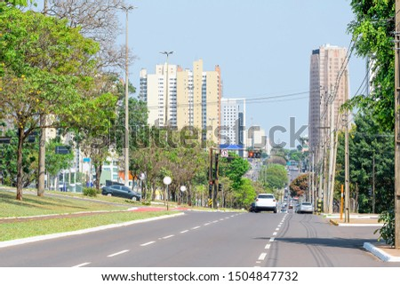 Tree-lined large avenue. City with many trees. Traffic at the Afonso Pena avenue - Campo Grande MS, Brazil. Main avenue of the city.  #1504847732