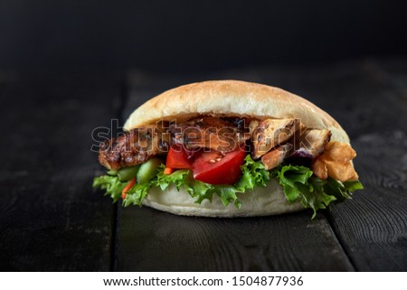close up of kebab sandwich on wooden background #1504877936