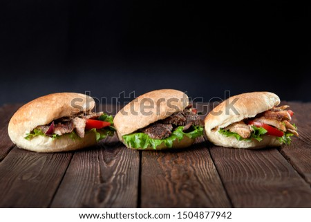 close up of kebab sandwich on wooden background #1504877942
