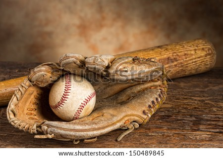 Old baseball bat with ball and weathered glove Royalty-Free Stock Photo #150489845
