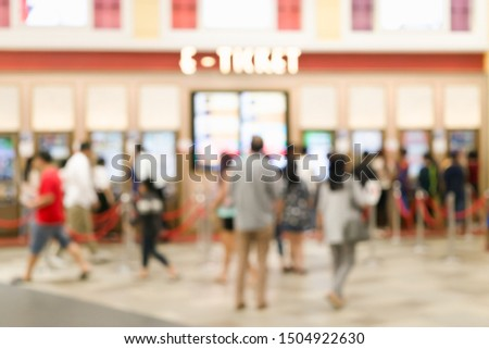 Abstract blurred defocus background of People buying ticket from movie e-ticket machine in Movie or Cinema Complex Lounge in front of the theater. #1504922630
