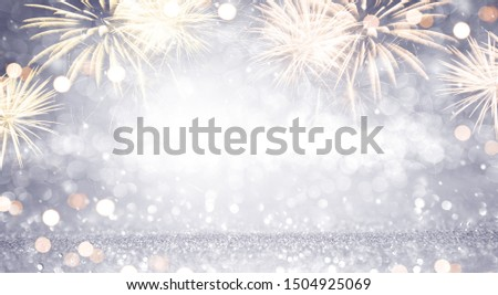 New Year Abstract background holiday, Gold and silver Fireworks and bokeh, copy space. #1504925069