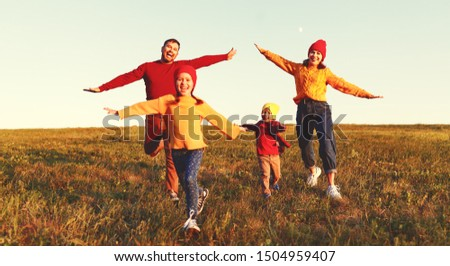 Happy family: mother, father, children son and  daughter on nature  on autumn sunset #1504959407