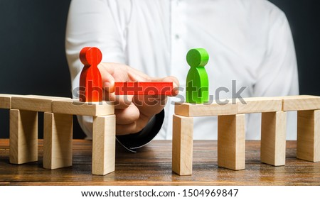 A man makes contact between people opponents. Arbitrator and mediator. Build bridges, seek a compromise in disputes and reconciliation of conflicts. Networking in business. Negotiation platform #1504969847