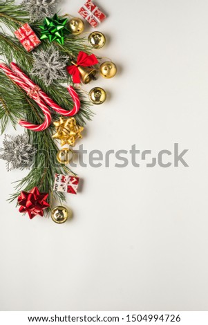 Christmas background. Gifts, Christmas bell, candy, red bows, Fir branches and decorations on a white background #1504994726