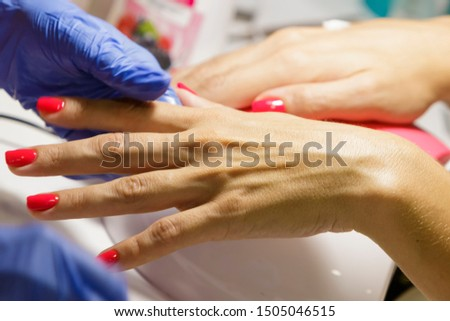 Female hand with manicure in the salon. #1505046515
