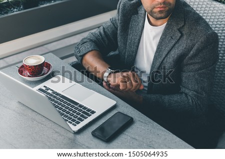 Young beard man using laptop on office, freelance work, outdoor close up hipster portrait, brutal, guy listening music on earphones, make photo and video, production, Bali, watch OS #1505064935