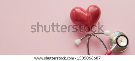 Red heart with stethoscope on pink background, heart health,  health insurance concept, World heart day, world health day #1505066687