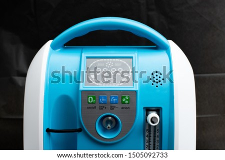 Medical Device Individual Blue White portable oxygen cylinder to put gas for patients with respiratory disorders, studio lighting black background #1505092733