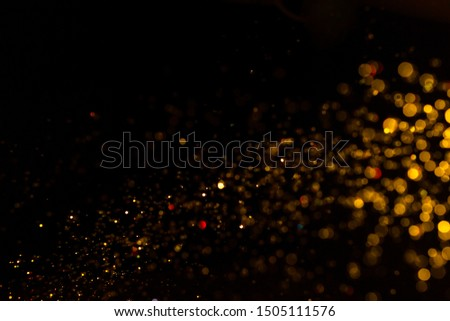 Gold bokeh of lights on black background #1505111576