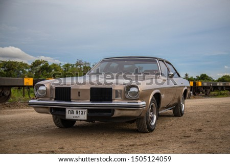CHONBURI, THAILAND - August 25, 2019: The 1974 Oldsmobile Cutlass  parking at the train station. #1505124059