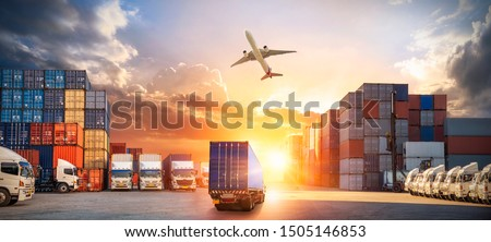 Container truck in ship port for business Logistics and transportation of Container Cargo ship and Cargo plane with working crane bridge in shipyard at sunrise, logistic import export and transport #1505146853