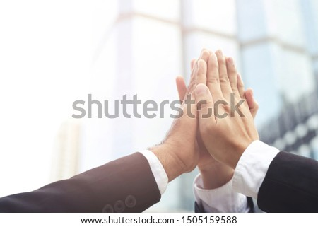 Give me five your clap hands articulate group businessman for good business team. concept Success and encouragement to overcome and overcame obstacles business solution strategy. #1505159588
