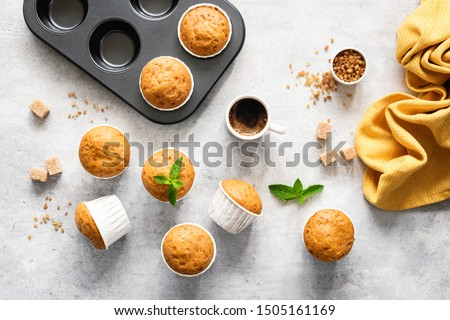 Homemade delicious vegetarian muffins with brown sugar on grey concrete background, flat lay, top view #1505161169