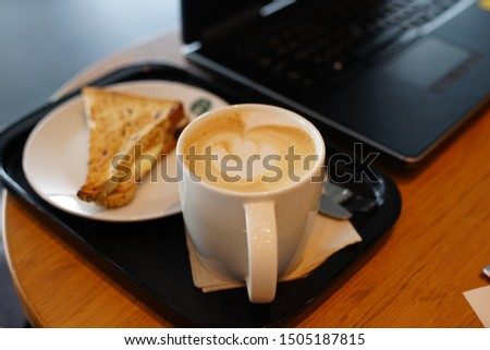 Close up Hot coffee with Brad beside laptop ,lifestyle of outside business meeting #1505187815