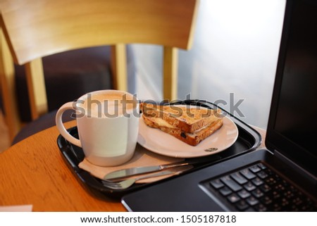 Close up Hot coffee with Brad beside laptop ,lifestyle of outside business meeting #1505187818