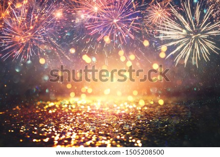 abstract gold, black and blue glitter background with fireworks. christmas eve, 4th of july holiday concept #1505208500