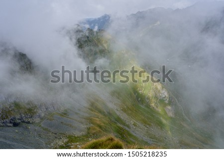 Picturesque landscape of mountain peaks in late summer #1505218235