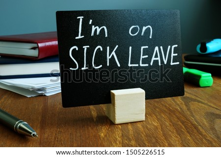 I am on sick leave sign on the workplace. Royalty-Free Stock Photo #1505226515