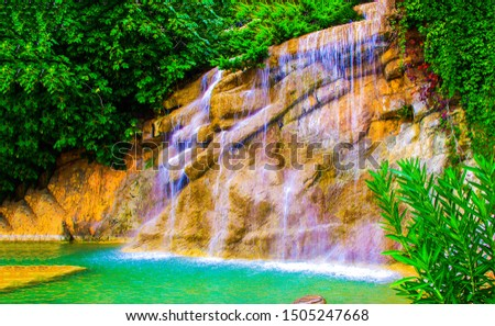 Waterfall rock in tropical forest. Tropical forest waterfall. Waterfall pool in forest. Forest waterfall view #1505247668