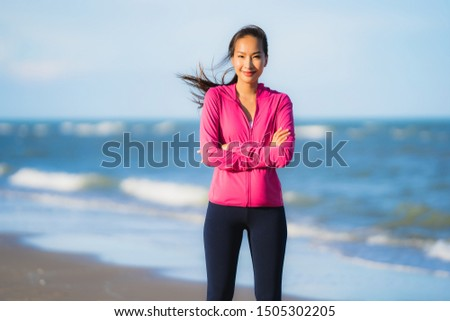 Portrait beautiful young asian woman running and exercising on the tropical outdoor nature beach sea ocean for healthy #1505302205