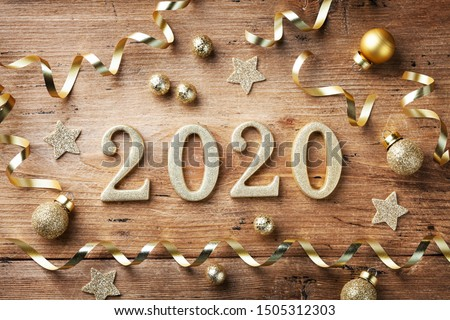 Happy New Year festive background with golden numbers 2020 and Christmas decorations on vintage wooden table top view.    #1505312303