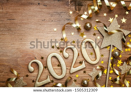 New Year celebration and festive background with golden numbers 2020, confetti stars and Christmas decorations top view. #1505312309
