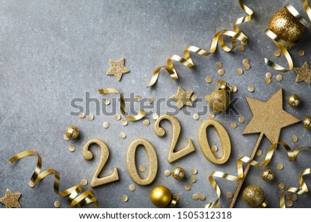 Holiday background with golden Christmas decorations and New year 2020 numbers and confetti top view.